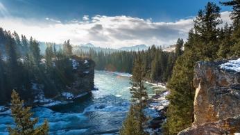 bow_river_alberta_canada_mountains_rocks_winter_trees_90856_1366x768