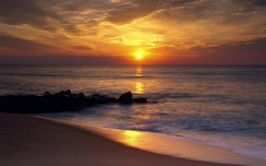 decline_sun_disk_beach_evening_harmony_orange_sand_wet_55793_1680x1050