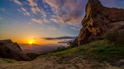 mountains_grass_sky_light_stones_86918_1366x768