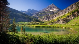 mountains_lake_grass_sky_summer_99494_1366x768