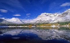 mountains_lake_ripples_sky_clouds_6433_1920x1200