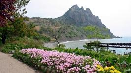 mountains_sea_flowers_91552_1920x1080