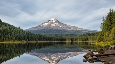 mountains_sky_reflection_rocks_84489_1366x768