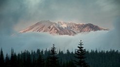 mountains_sky_trees_fog_99763_1366x768