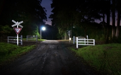 night_crossing_signs_road_84670_2560x1600