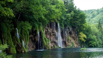 river_cliffs_waterfalls_trees_landscape_86265_1366x768