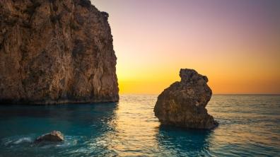 sea_boulders_sky_sunrise_87677_1366x768