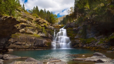 spain_aragon_falls_stones_clearly_clouds_sky_moss_wood_60904_1366x768