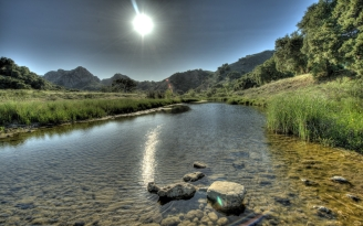 sun_light_river_water_transparent_stones_day_summer_45899_1680x1050