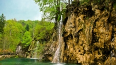waterfall_river_currents_grass_stones_trees_84413_1366x768
